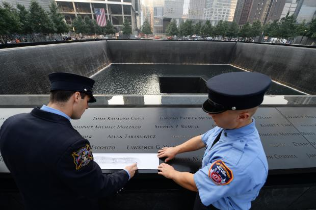 The annual recitation of victims' names began at 8:39 a.m. at the 9/11 memorial.