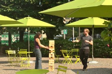 The oversized Jenga game in Freeman Plaza West rises 6 feet tall.