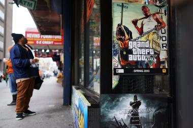 "Three Staten Island residents were arrested after they posed as cops to cut the line at the midnight release of ""Grand Theft Auto V."""