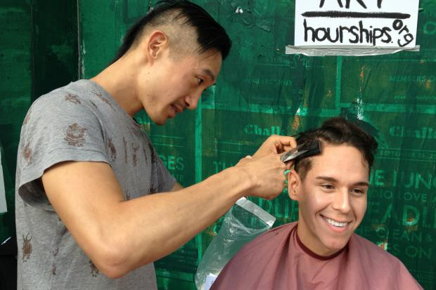 Steven Chu offered free haircuts Thursday on a corner on Bedford Avenue.