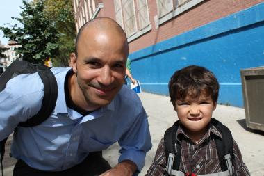 Malcolm Hansen, 44, a graduate student outside of P.S. 125 Ralph Bunche Elementary with is son Wren, 3, after his first day of pre-K.