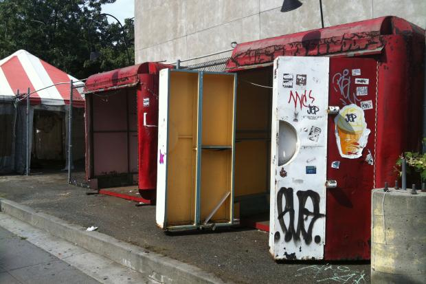 Three abandoned kiosks, which have lay in ruin over the past few years, are finally being removed from the neighborhood.