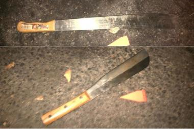 Two machetes police recovered from the scene of a cop-involved shooting on September 7, 2013.