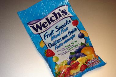 A man was arrested after leaving his three young children alone to sell fruit snacks in the street.