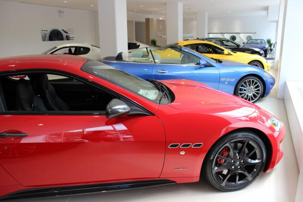 The Italian carmaker opened a dealership across from DeWitt Clinton Park.
