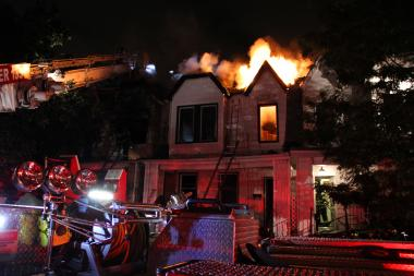 A fire swept through six Middle Village homes Monday night, the FDNY said.