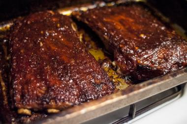 These ribs combine a savory rub with a sweet and tangy homemade barbecue sauce.