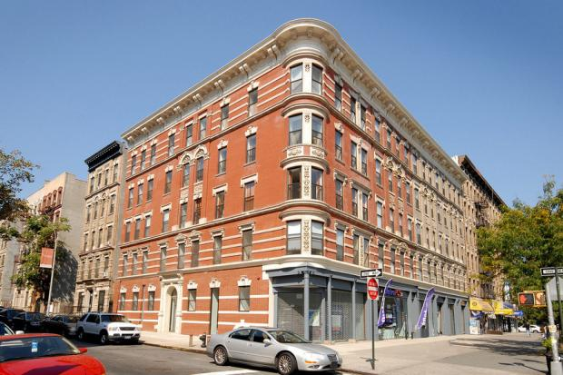 Four developmentally disabled men share a $550,000 condo at Savoy West on Lenox Avenue in Harlem. There was resistance from the community to the plan but organizers say it is working out well.
