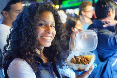 "A guest at last year's ""Viva La Comida!"" enjoys the food."