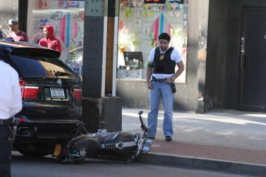 A man was critically injured when he crashed into the back of a parked car on Roosevelt Avenue and 64th Street on Sept. 17, 2013.