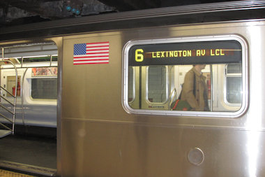 A man was riding atop a 6 train through Soundview when he hit his head and died, police said.