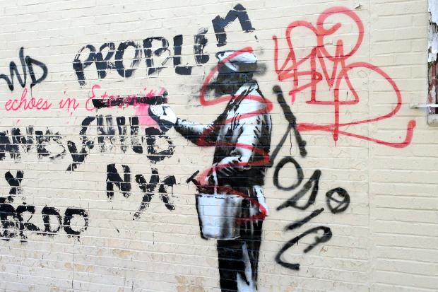 The famed British street artist's latest work in Woodside was tagged up less than a day later.