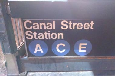 Fire on the tracks in the Canal Street subway station disrupted Thursday morning's commute, the MTA said.