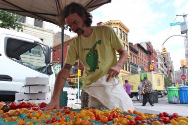 Trevor Kunk, chef of Blue Hill, chooses tomatoes at Union Square Greenmarket's Berried Treasures Farm for produce.