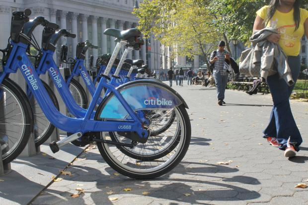 Two pedestrians say they plan to sue the city, claiming they were injured when they tripped over a Citi Bike station.