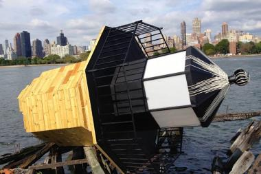 David McQueen's fallen lighthouse at Socrates Sculpture Park translates texts into morse code messages.