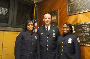 Officers of the month pose with 71st Precinct Commander Deputy Inspector John Lewis. After weathering one of the most dramatic crime increases in New York City this year, the precinct is on track to break even with its crime rate in 2012.