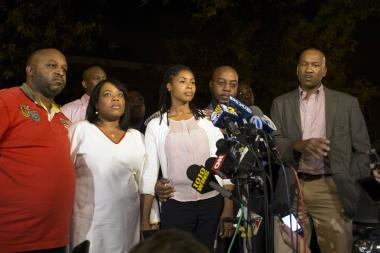 Eric Sanders (R) stands with the family of Miriam Carey while they address media outside a home in Bedford-Stuyvesant on Oct. 4, 2013. A federal judge ordered Sanders' arrest last week, saying he has refused to comply with the court's orders.