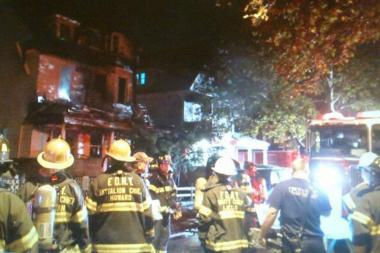 A massive fire tore through an East 35th Street home, injuring three, the FDNY said.