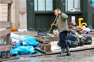 Clearing up the debris post-Sandy in the South Street Seaport.