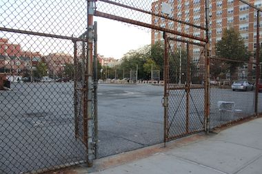 The group is hoping to revive a plan to turn the asphalt schoolyard into a community park.