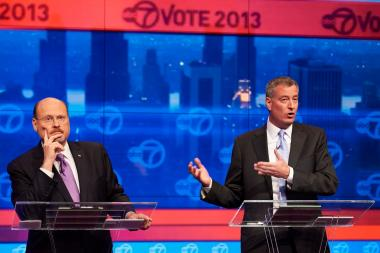 Republican mayoral candidate Joe Lhota, left, and Democratic candidate Bill de Blasio participate in their first televised debate Oct. 15, 2013.