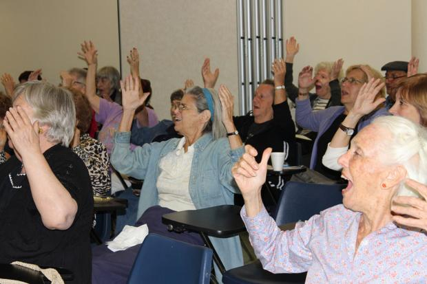 Seniors taking a class at JASA decided to bring their laughter yoga out into the public with a flash mob.