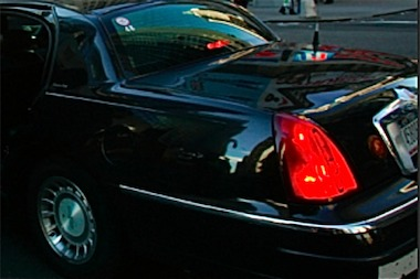 An Asian chauffeur driving his boss of more than 20 years was accused by city inspectors of operating an illegal livery cab.