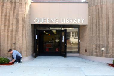 The library, which was severely damaged by Hurricane Sandy, will reopen nearly a year after the storm.