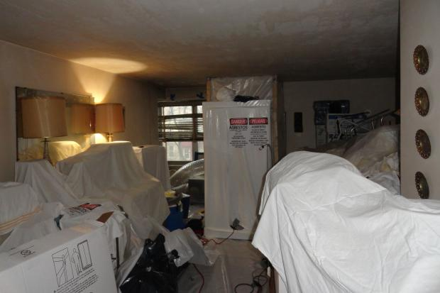 The co-op hired dozens of new staff to deal with hoarders who did not want to move their belongings during the renovation.