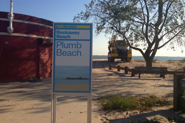 The signs include one labeled as Rockaway Beach and a misspelled Plumb Beach sign.
