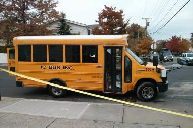 A truck slammed into a school bus carrying four kids in Eltingville, officials said.