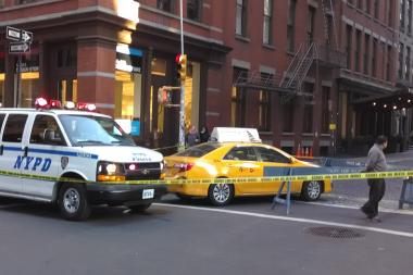 A taxi slammed into a pedestrian in SoHo Friday morning.