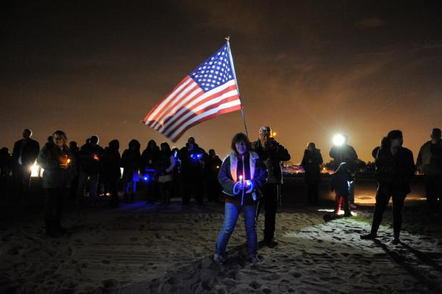 Staten Island residents commemorate Hurricane Sandy, one year later, on the shoreline in Midland Beach on October 29, 2013