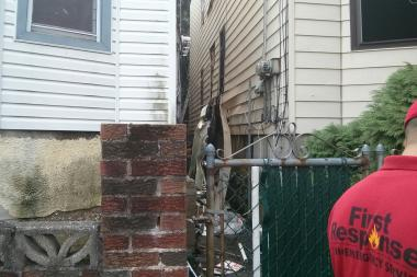A fire raced through the basement of a Tompkinsville home Wednesday morning, the FDNY said.