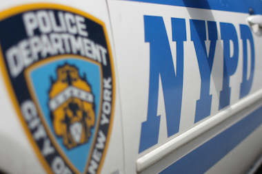 An off-duty NYPD school crossing guard was charged with leaving the scene of an accident after she backed into a pedestrian in Jamaica and fled, police said.