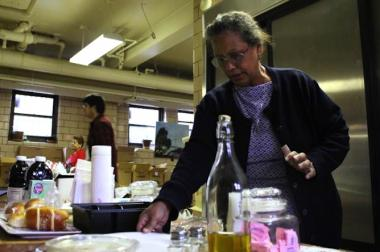 Aixa Torres prepares for a Thanksgiving meal in 2011, when a gas outage threatened residents' ability to roast turkeys.