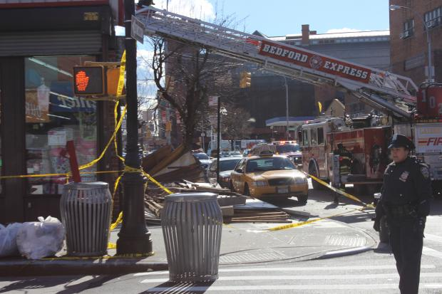 A large sign fell outside a Bed-Stuy building, leaving two in serious condition, officials said.