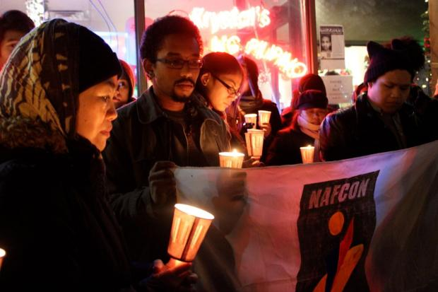 "Dozens gathered in Queens' ""Little Manila"" Wednesday for a vigil for the victims of Typhoon Haiyan."