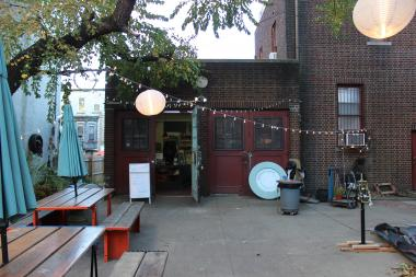 Bread Love, a Bed-Stuy bakery and outdoor cafe in the stable house of the 375 Stuyvesant Ave. Mansion, caught fire on May 14, 2014.