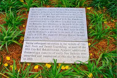 The marker, placed in City Hall Park on Nov. 10, 2013, honors those whose remains were reburied.