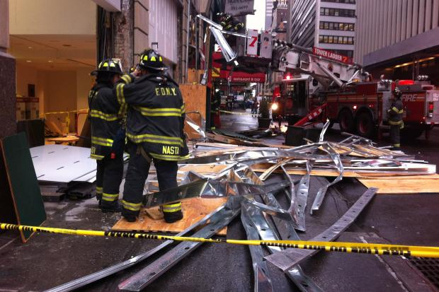Three people were being treated at the scene after scaffolding collapsed on 40th Street, the FDNY said.