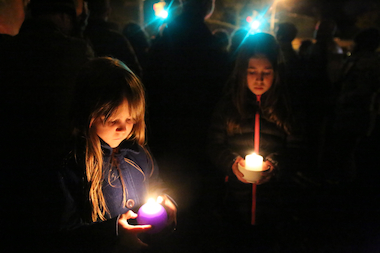 "Two little girls hold candles in memory of 9-year-old Lucian Merryweather who was killed by a man driving an SUV that jumped the curb in Fort Greene. ""This affects me because it is dangerous on these streets,"" said young person Esme Bauer (not pictured here).  ""I've lived here my whole life and I know we can make it safer."" ""You can be late sometimes when you are driving your car,"" she added. ""You can slow down."""
