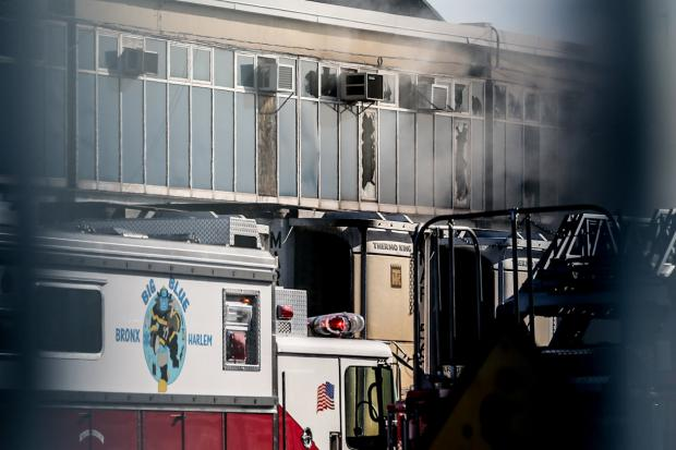 Fire fighters battled a 4-alarm fire in the city's largest produce market in Hunts Point on Nov. 20, 2013, officials said