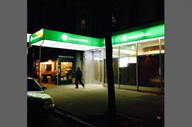 The bright lights from the sign and green awning at the new Investors Bank branch at 431 Court St. The lights from the awning and sign have since been shut off.