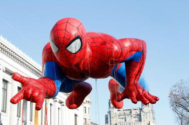 A man dressed as Spider-Man punched a police officer in the face on Saturday, according to the NYPD.