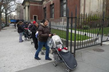 A nanny outside the Park Slope public library. A 2013 survey by Park Slope Parents found that nannies earn an average of $15.79 an hour.