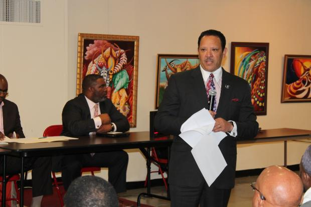National Urban League President Marc Morial defended the civil rights group's plans Thursday to build its headquarters on 125th Street in front of a hostile Harlem crowd furious that four minority merchants say they will be put out of business by the project.