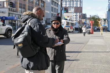 State Sen. Bill Perkins gathered signatures asking Governor Andrew Cuomo to help keep small businesses on 125th Street from being displaced because of a National Urban League development project, Nov. 10, 2013.