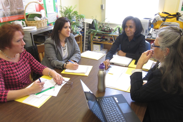 P.S. 107's principal and others observe a fourth grade teacher.